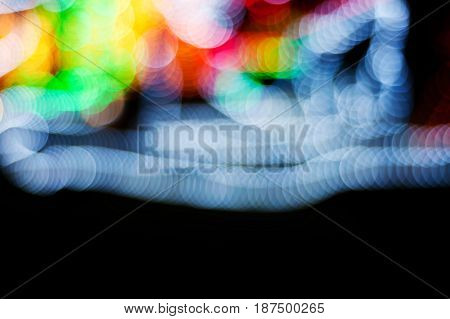 Bokeh christmas light night city abstract colorful blurred on black background