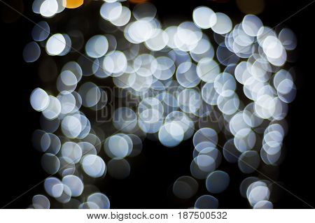 Bokeh christmas light night abstract colorful blurred on black background