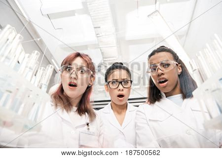 low angle view of scientists group in white coats in laboratory