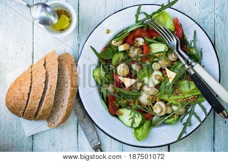 Marinated mushroom salad with cheese and mustard sauce