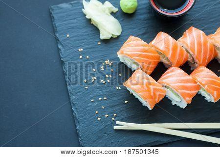 Philadelphia Roll Classic Dark Stone On The Board. Salmon, Philadelphia Cheese, Cucumber, Avocado. J