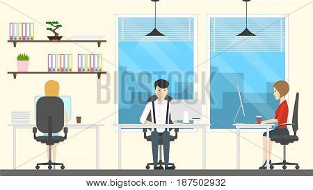 People in office working at the tables with computers.