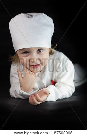 The girl plays in the nurse. Portrait of a doctor