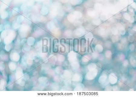 Colorful summer bokeh background in blue tones.
