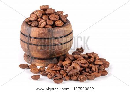 coffee beans in a wooden bowl isolated on white background.
