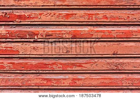 Cracked Red Paint On A Wooden Wall