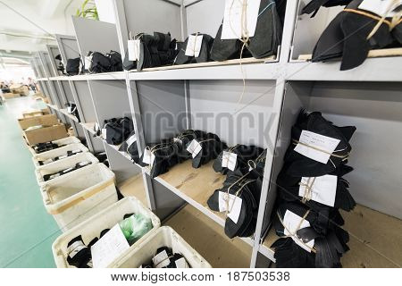 MOSCOW, RUSSIA - FEBRUARY 21, 2017: Moscow shoe factory JSC RALF RINGER. Cutting of leather parts in a plastic boxes. Shoe factory