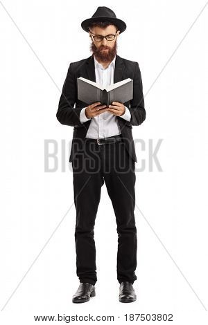 Full length portrait of a religious man reading a book isolated on white background