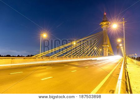 Maha Chesadabodindranusorn Bridge in Nonthaburi Thailand sunset