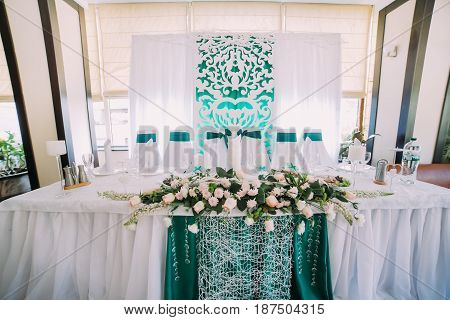 The close-up view of the wedding table set decorated with flowers