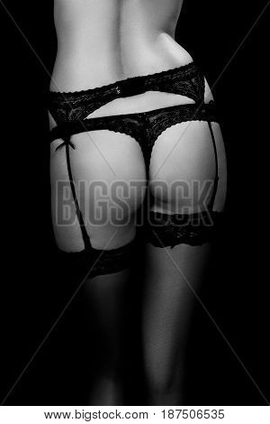female buttocks and feet in lingerie and stockings, monochrome