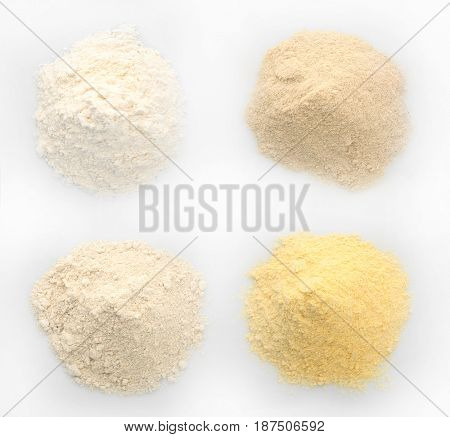 Different kinds of flour on white background