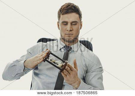 Businessman holding hourglass.