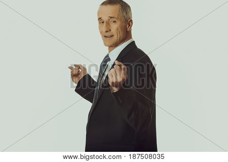 Businessman with hands on both sides