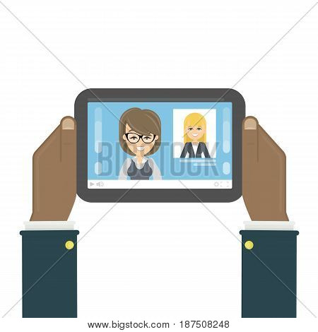 Tablet with news on the screen. African male hands holds device with news presenters.