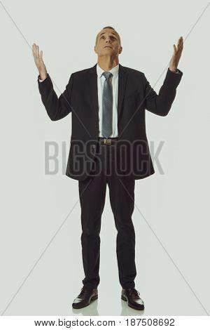 Businessman with hands open gesture