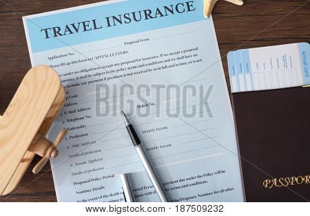 Pen on blank travel insurance form, closeup