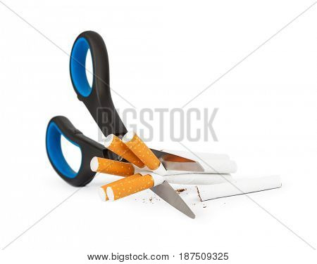 Scissors and cigarettes isolated on white background