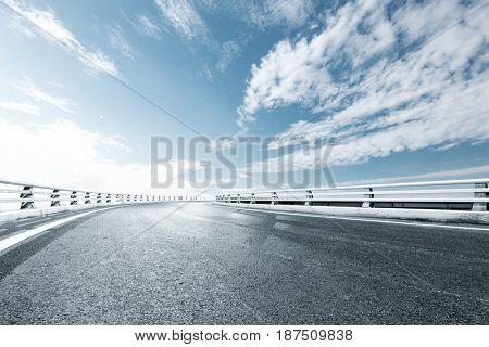 empty road in blue sunny sky