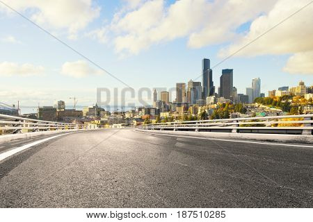 empty road with landmark buildings in los angeles