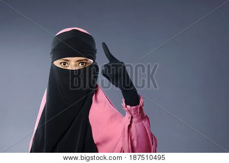 Portrait Of Asian Muslim Woman In Veil With Angry Expression