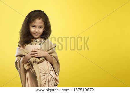 Cheerful Asian Muslim Child With Traditional Dress