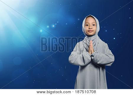 Little Asian Muslim Girl In Traditional Dress Praying