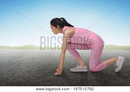 Sporty Asian Woman Fit In Ready Position To Running Exercise