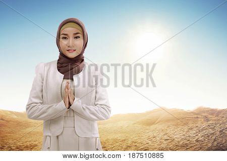 Young Asian Muslim Woman In Hijab With Smiley Face Standing