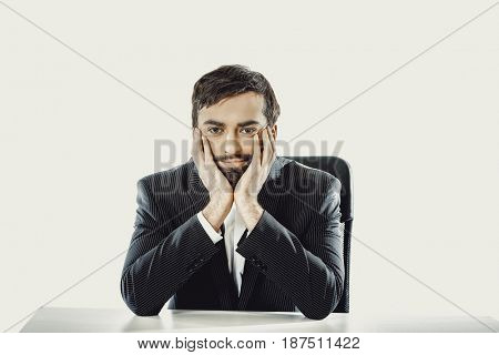 Businessman sitting at the desk.