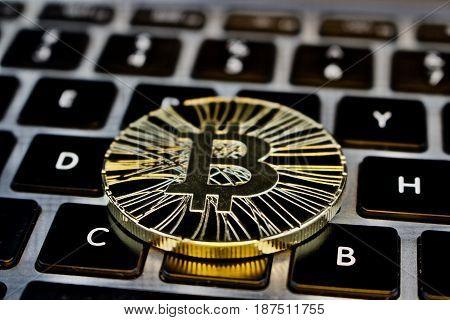 Gold Bitcoin Coin On The Keyboard