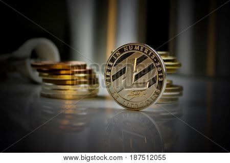 Digital currency physical silver litecoin coin in dark scene