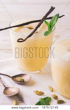 Traditional Indian Mango Lassi With Cardamon, Mint, Vanilla And Saffron