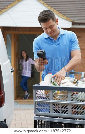 Driver Delivering Online Grocery Order To Female Customer