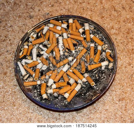A lot of cigarette butts in the bowl