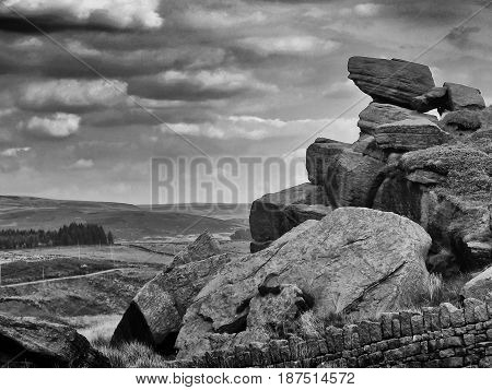 rocky outcrops and stone walls on the yorkshire moors - pennines