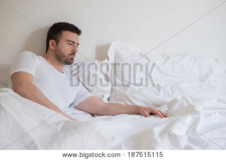 Sad And Upset Man Waking Up Alone In The Morning