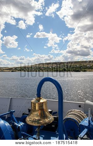 The ship's bell and the river landscape