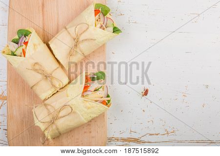 Tortilla wrap with chicken and vegetables, copy space