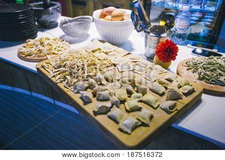 Man making ravioli, Italian cuisine and gluten-free
