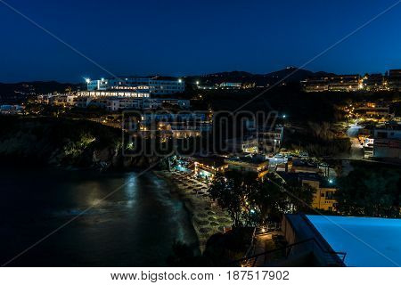 AGIA PELAGIA GREECE - JULY 06 2016: The municipal beach at Mononaftis village in evening lights. Crete.
