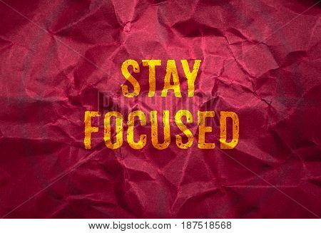 Stay Focus In Gold Texture On Crumpled Red Paper Background,business Concept