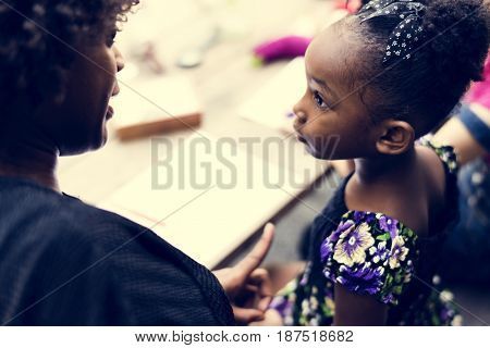 African descent girl is listening to her teacher