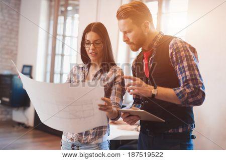 Coworking process, designer team working in modern office