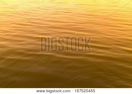 Yellow color abstract background of liquid wave based on water wave