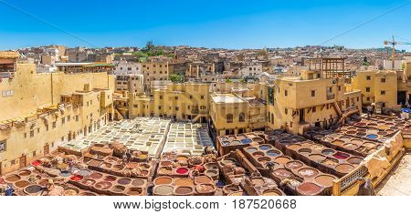 FEZ, MOROCCO - APRIL 6,2017 - Panoramic view at the Chouwara Tannery in the old medina of Fez. Fez city has been called the