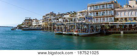 CRETE GREECE - JULY 11 2016: Panoramic view of the embankment of a small elite tourist town - Elounda municipality of Agios Nikolaos.