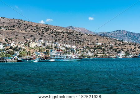CRETE GREECE - JULY 11 2016: View from the sea on the north coast of Crete on the west side of the Gulf of Elounda.