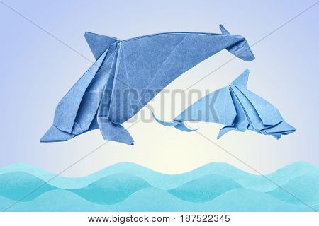Dolphins origami jumping in wave on suneice background