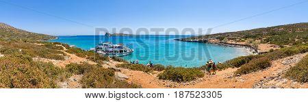CRETE GREECE - JULY 11 2016: Beautiful bay. Kolokitha beach. Peninsula Kalydon. The island of Crete. A popular tourist destination. Panoramic view.